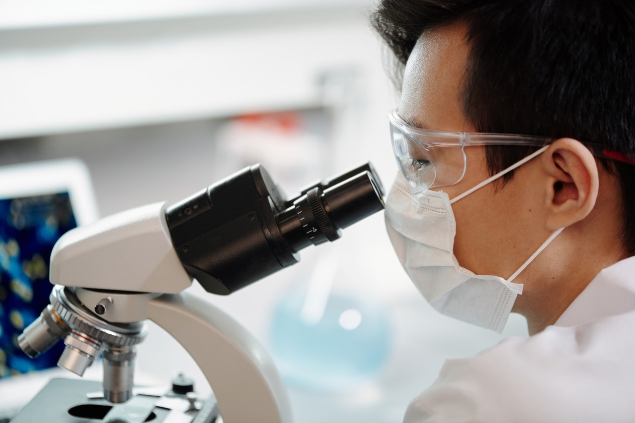 Man looking at a microscope